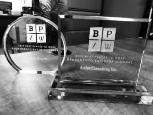 Sacramento Business Journal Best Places to Work Awards on a Bookshelf