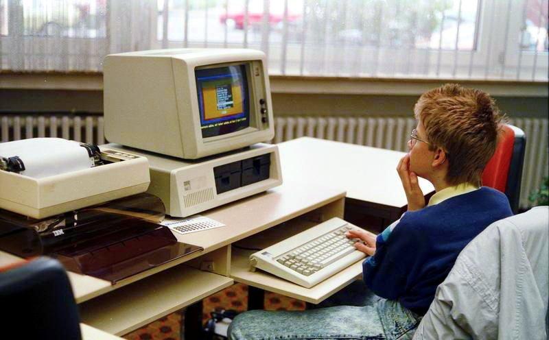 Person sitting at a 1988-era computer.